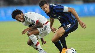 Luiz Adriano vs Marco Andreolli nel derby cinese